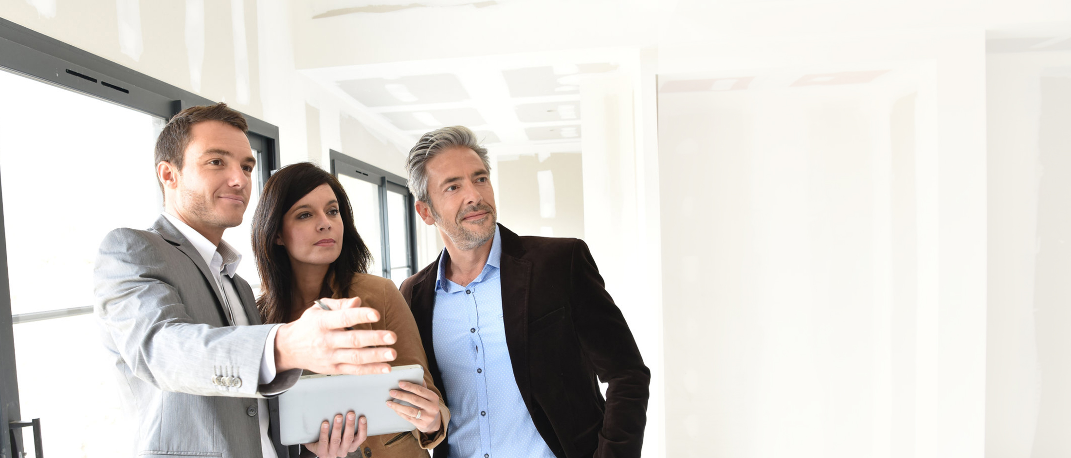 Couple with realtor visiting house